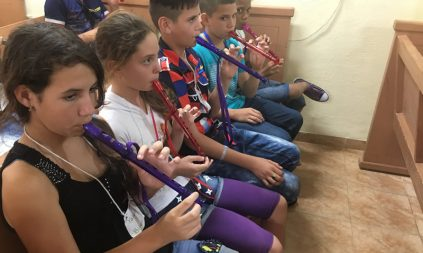 students playing recorder in school